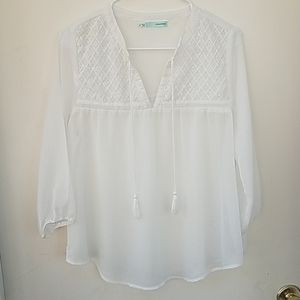 Maurice's small white peasant blouse